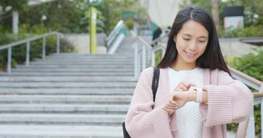 Woman using smart watch at outdoor