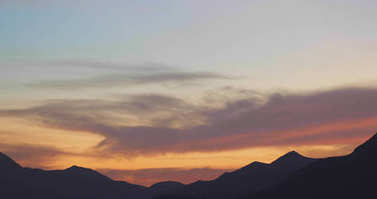 Sunset with clouds and mountains view