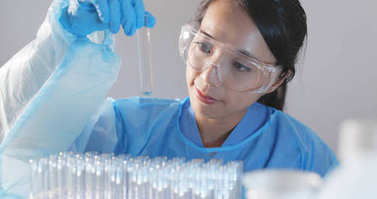 Woman scientist doing research in laboratory