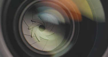 Professional camera lens zooming in and out