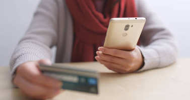 Shopping online with cellphone and credit card