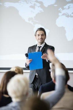 Public speaker asking questions during seminar