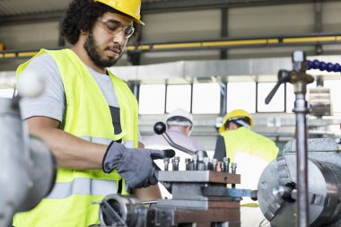 manual worker operating machinery