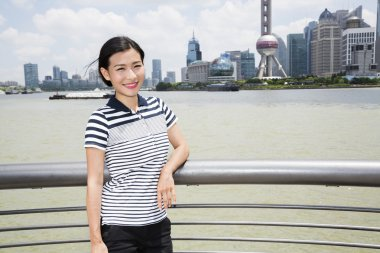 woman with Oriental Pearl tower in background