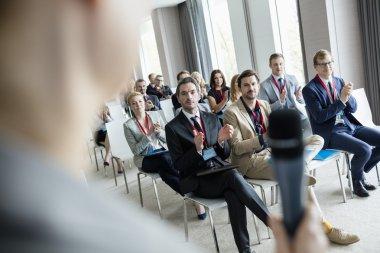 Business people applauding during seminar