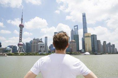 Man looking at Pudong skyline