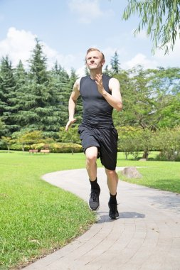 Fit man running in park