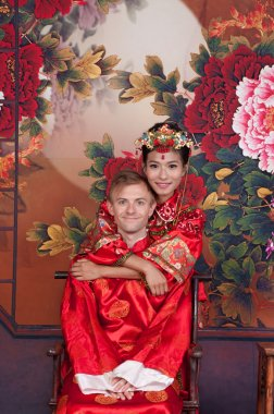Bride and Groom in Chinese wedding outfits