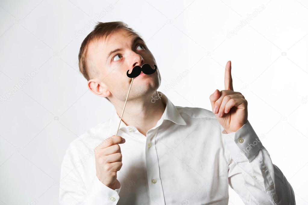 Man wearing fake mustache