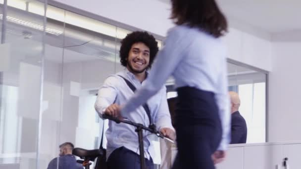 Happy businessman arriving to office on bicycle