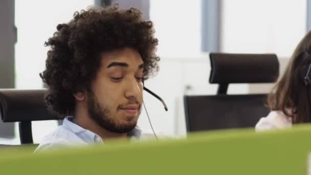 Employees working in call centre office