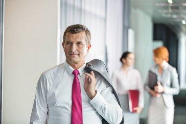 Businessman holding coat over shoulder