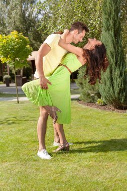 Couple dancing in park