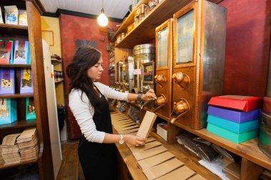 salesperson dispensing coffee beans
