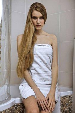 woman wearing a towel in bathroom