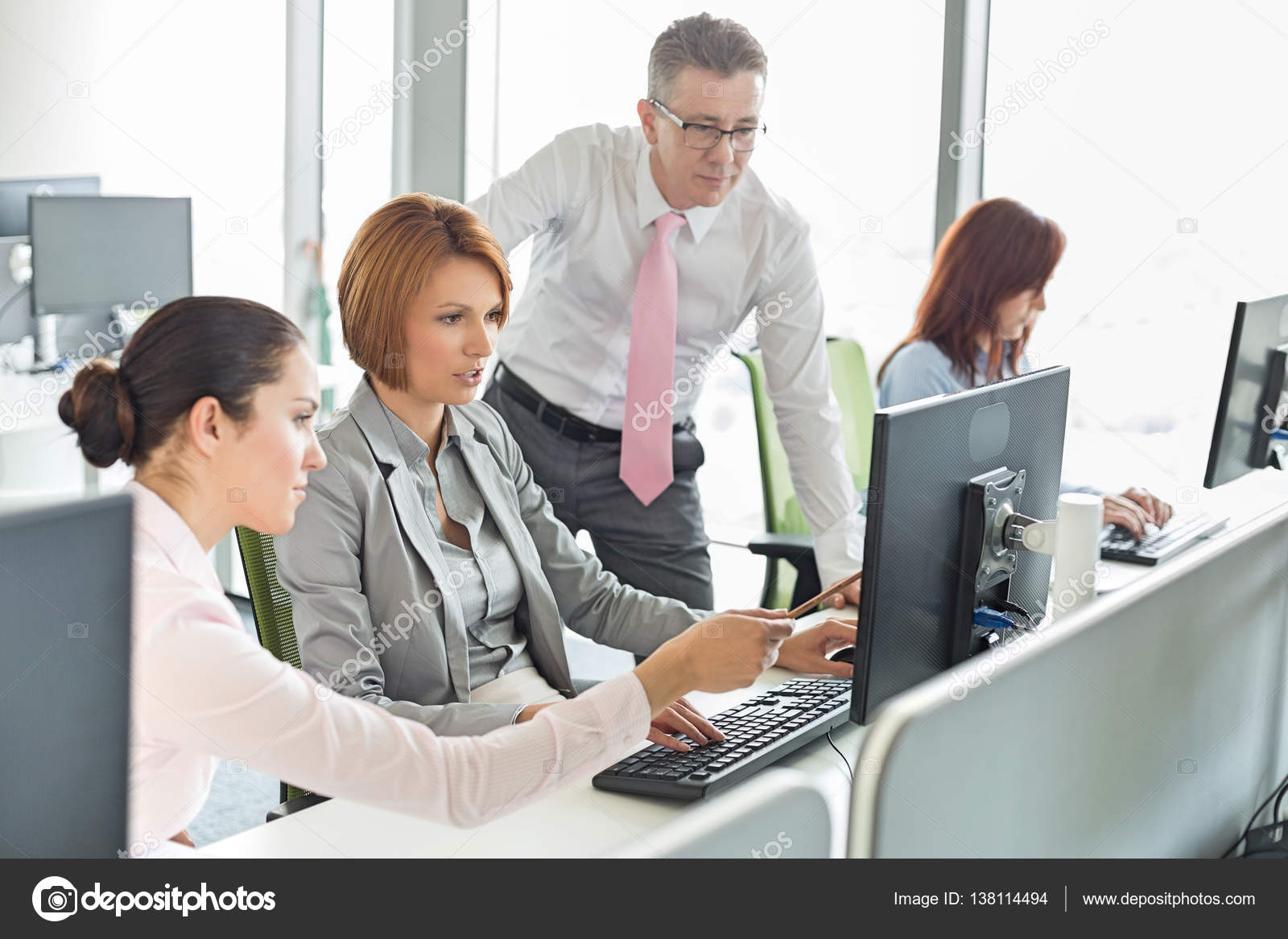 Business people working on computer ⬇ Stock Photo, Image by © londondeposit  #138114494