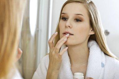 Woman touching lips