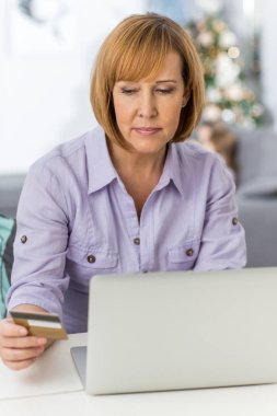 Mature woman shopping online