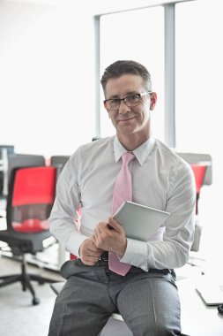 Confident businessman with tablet PC