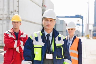 Confident workers standing