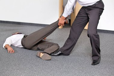Businessmen pulling colleague