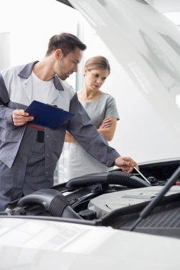 engineer explaining car engine