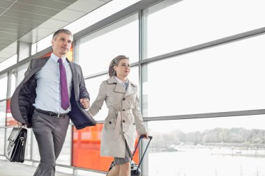 Businessman and businesswoman rushing