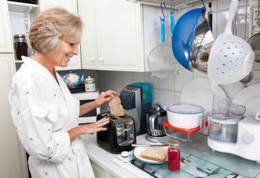 senior woman preparing toast