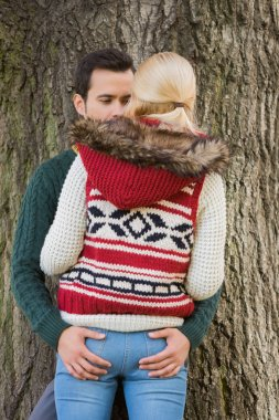 Passionate couple against tree