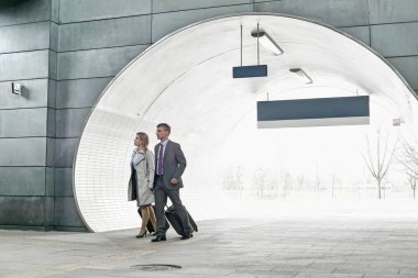 Businessman and businesswoman at railroad station