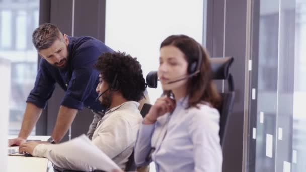 Multi ethnic group of workers working in a call center office