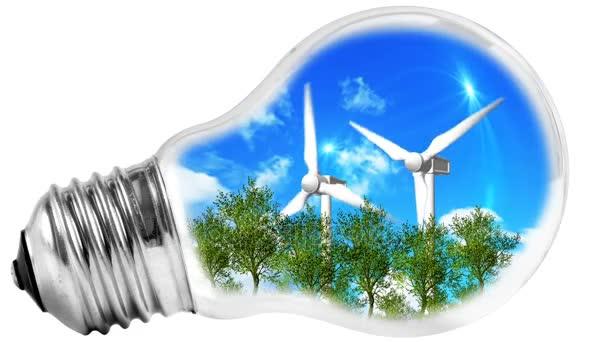 Žárovka s trávou a větrný mlýn uvnitř