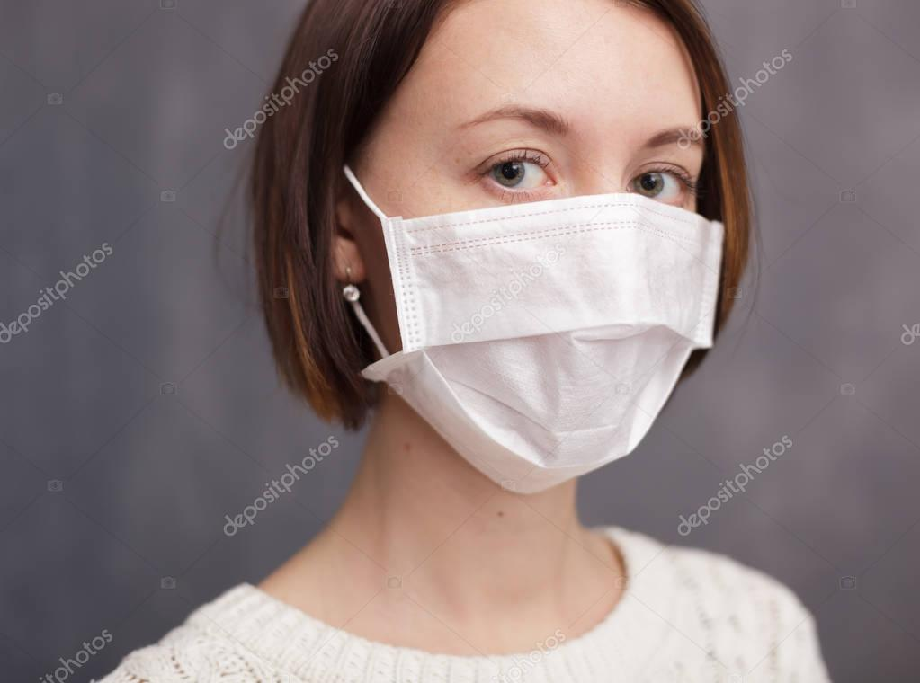 Girl in medical disposable mask