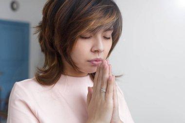 Asian girl praying to God
