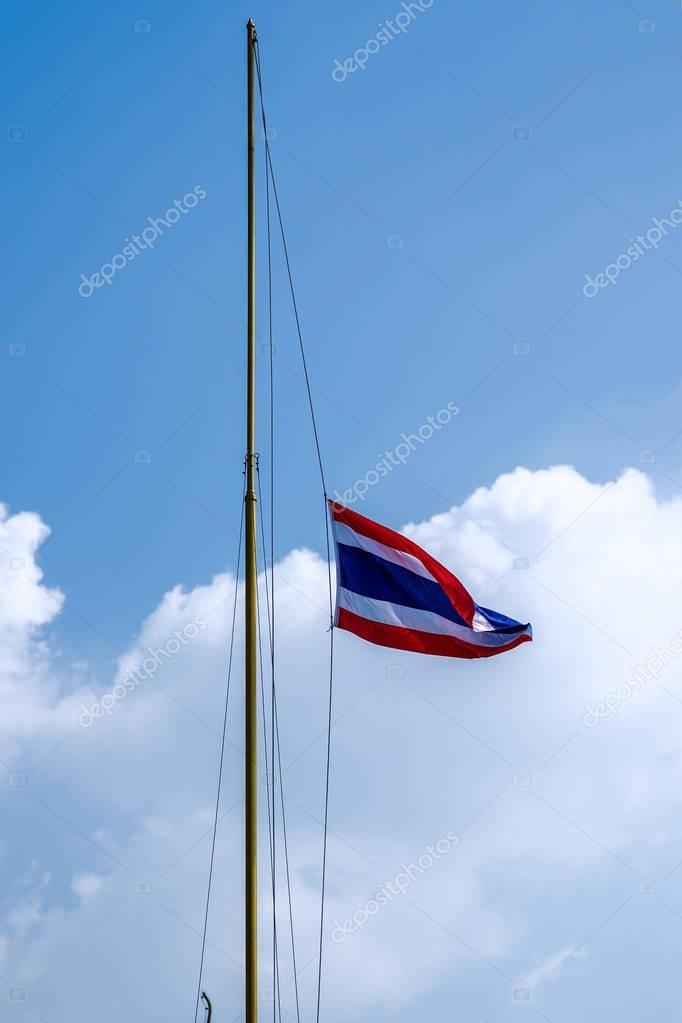Waving Thai flag of Thailand with blue sky