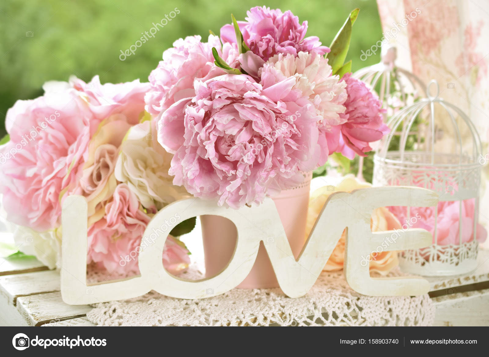love decoration with wooden letters and peony flowers with color ...