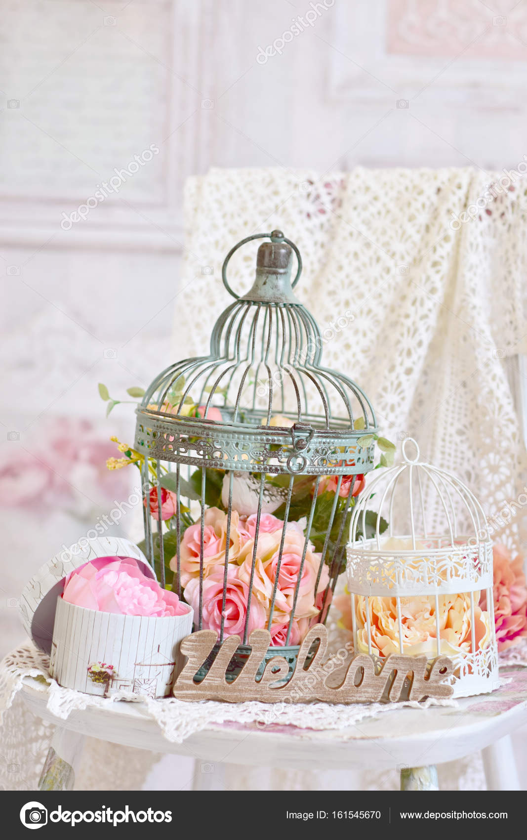 Vintage Style Decoration With Flowers In Old Bird Cages Stock