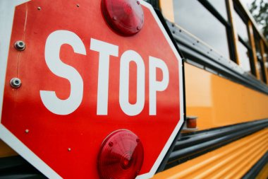 school bus and red stop sign
