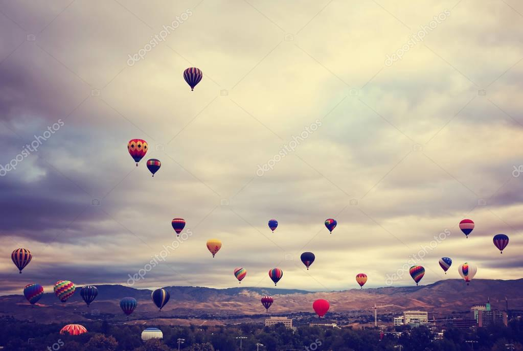 hot air balloons in the sky during sunrise