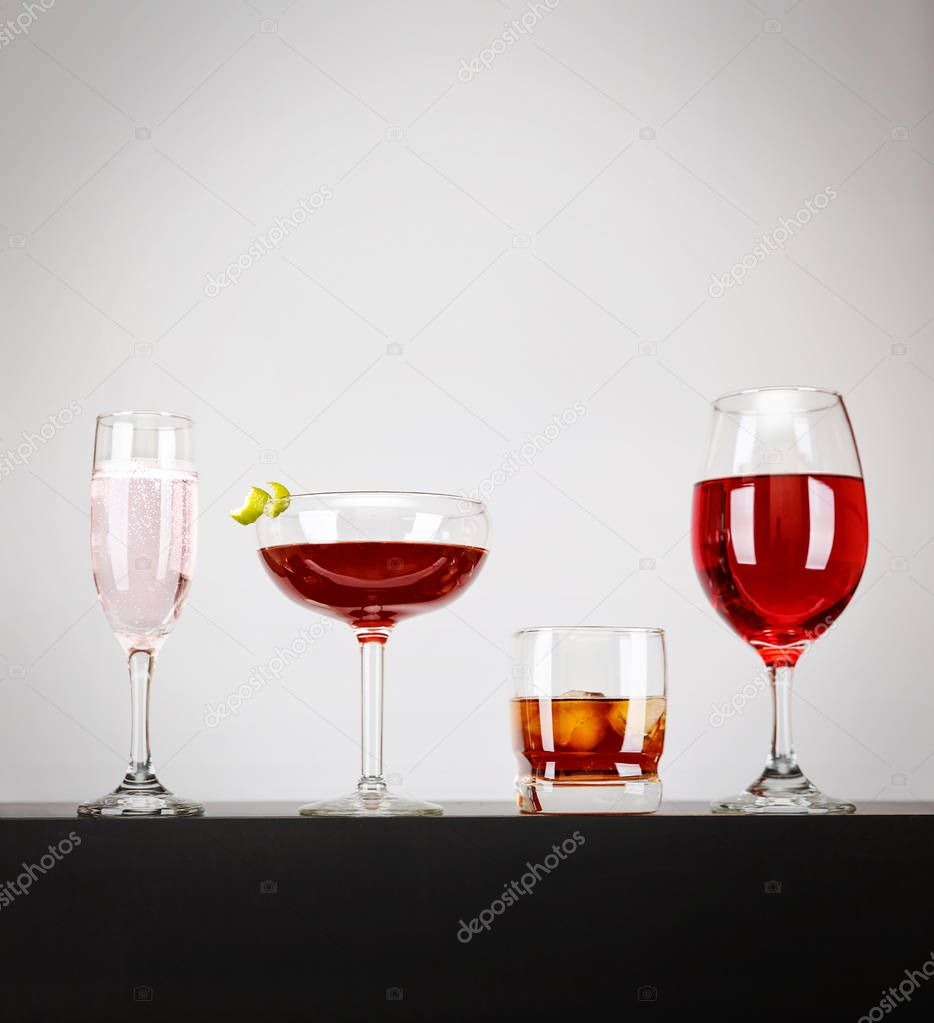 line of cocktails on a bar