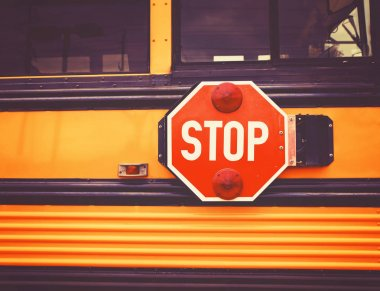 school bus and the big red stop sign