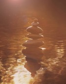beautiful stack of rocks in the water toned with a retro vintage instagram filter