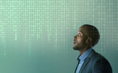 Business man with hologram binary code
