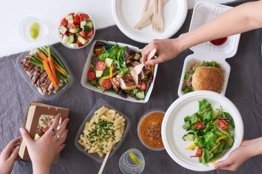 people eating takeaway food