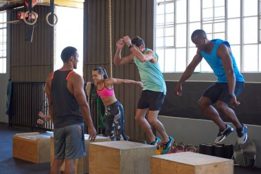 active people doing box jumps