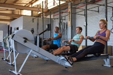 sportive people using gym equipments