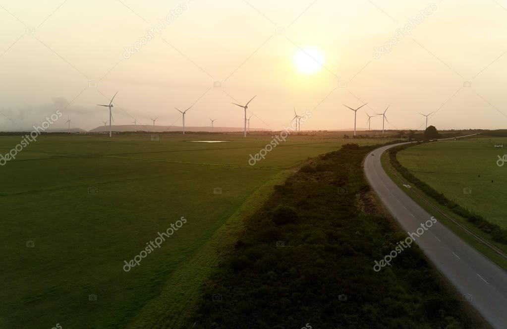 silhouettes of wind farm turbines