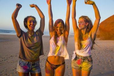 Three girls full of colored powder