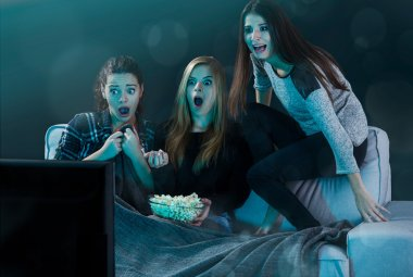 Scared teenage girls watching movie