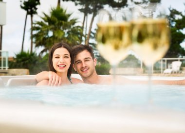 Man embracing woman in jacuzzi